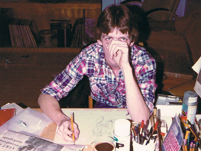 "John ""Derf"" Backderf drawing Lantern cartoons in his dorm room in Siebert Hall in 1982."
