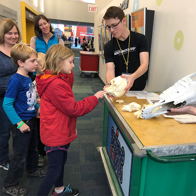 One outreach project included students hosting interactive carts at COSI, where APOP members engaged with children and their parents and led them through mini-exhibits about physical anthropology, bioculturalism and archaeology.