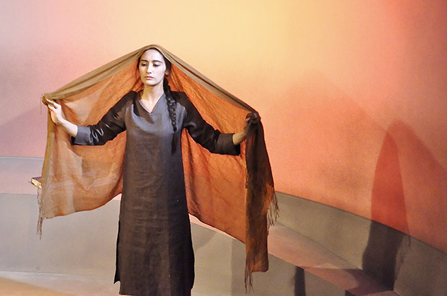 "An actress performs in ""Behind the Blast Wall"" by Sonali Bhattacharyya, produced by Palindrome Productions, October 2017, London. Image by Manuela Chastelain."