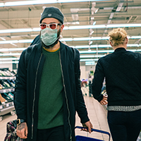 Man in grocery store wearing mask