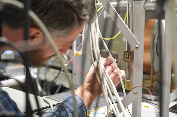 CEM grad student Andy Berger works in the lab