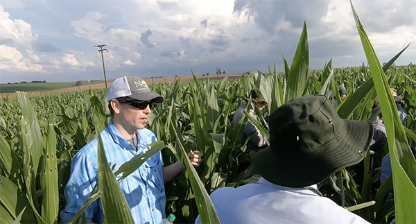 Bart Elmore at a corn field in Brazil with farmers.