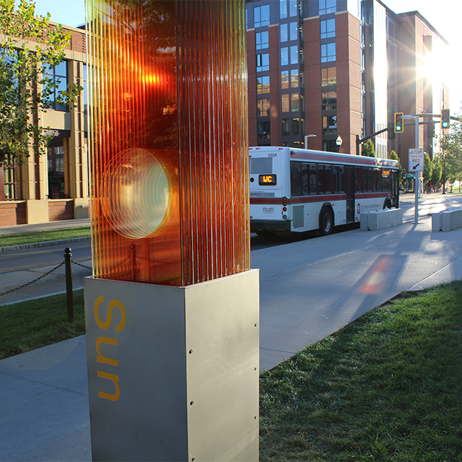 """The Solar System to Scale"" comprises 10 mixed-media kiosks that begin with a ""sun"" kiosk on Woodruff Avenue outside of CBEC and end with a ""Pluto and Beyond"" kiosk near the Chadwick Arboretum Learning Gardens on West Campus."