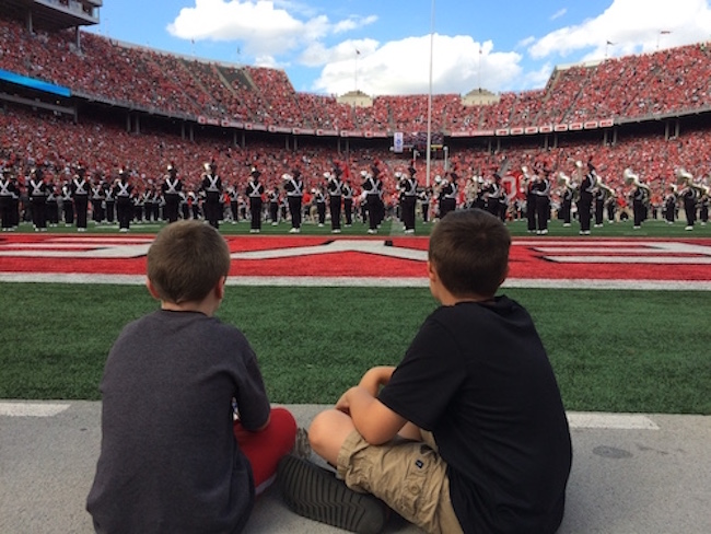Two Special Spectators watch OSUMB perform during halftime