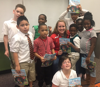 Kelsey Crawford (center) poses with students after a reading