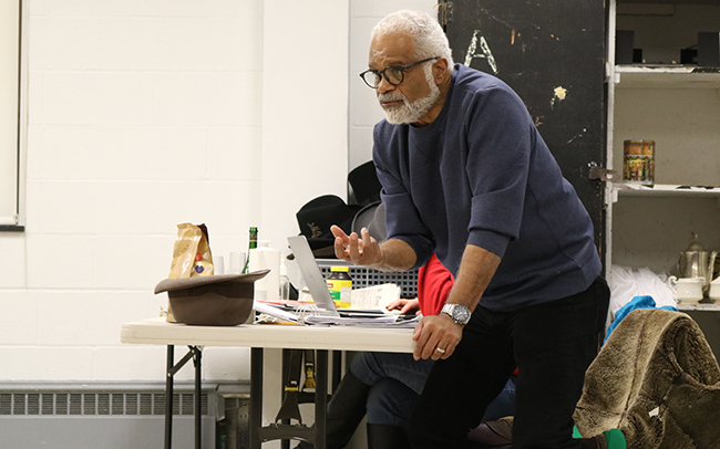Ted Lange gives instructions to his cast during rehearsal.