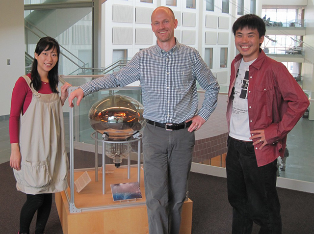 John Beacom (center) stands with former postdoc Kohta Murase (right) and Murase's wife, Chisako Murase (left)