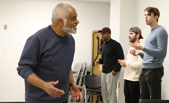 """""""Red Velvet"""" guest director Ted Lange leads the production's cast in warmups before rehearsal."""