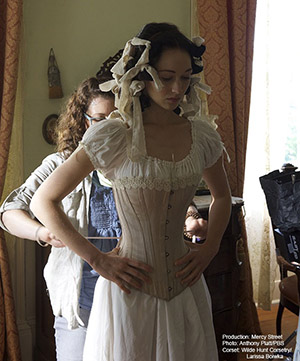 "Actress Hannah James gets fitted in one of Boiwka's corset on the set of PBS's ""Mercy Street,"" photo courtesy of Anthony Platt/PBS"