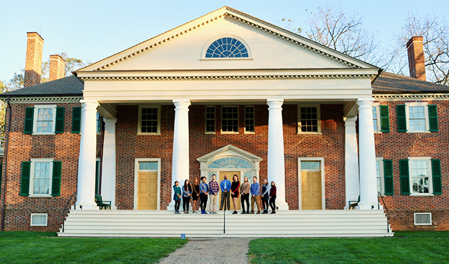 Associate history professor Hasan Jeffries and his students stand outside of James Madison's Montpelier.