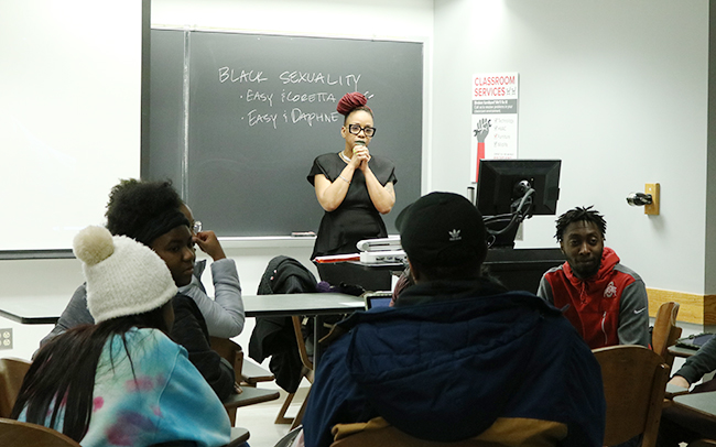 "Lecturer Celia Peters, a filmmaker, observes students during an exercise in her class, ""Black Visual Culture and Popular Media."""