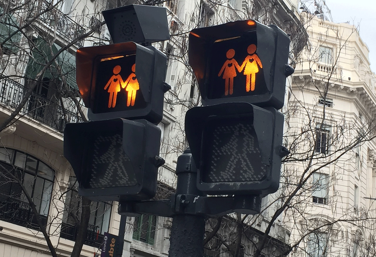 Crosswalk signs with symbol of two women holding hands