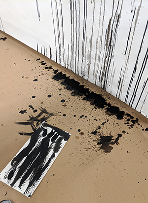 Ink dripping to the floor.