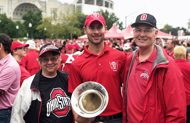 Rob Gast stands with his parents, Bob and Lynn Gast, before the Ohio State-Tulane football game on Sept. 22.