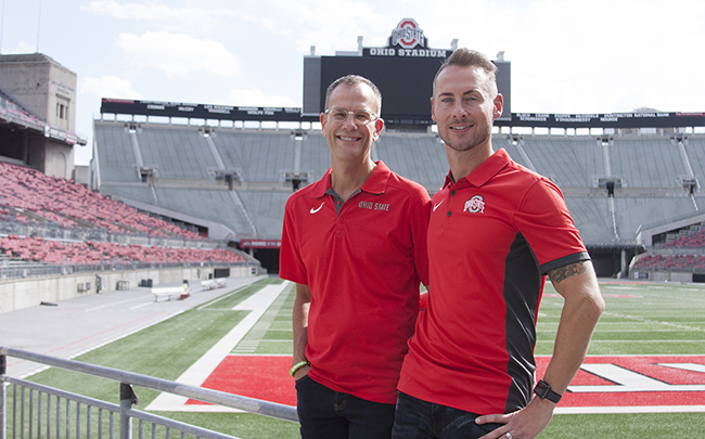 Rob Gast (right) stands with his fiance, Matt Hall, at Ohio Stadium.