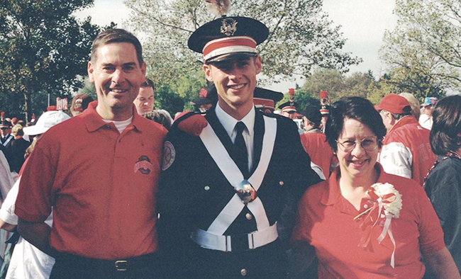 Rob Gast stands with his parents, Bob and Lynn Gast, in 1998.