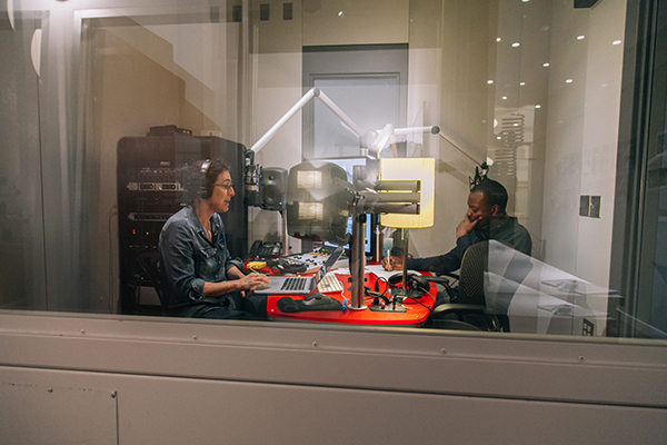 """Serial"" host Sarah Koenig, left, in the recording room with co-host and reporter Emmanuel Dzotsi. Photo credit Sandy Honig"