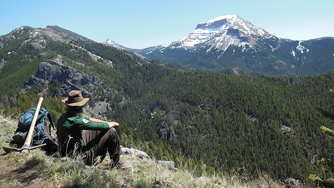 Schoessow sits among the Montana wilderness.