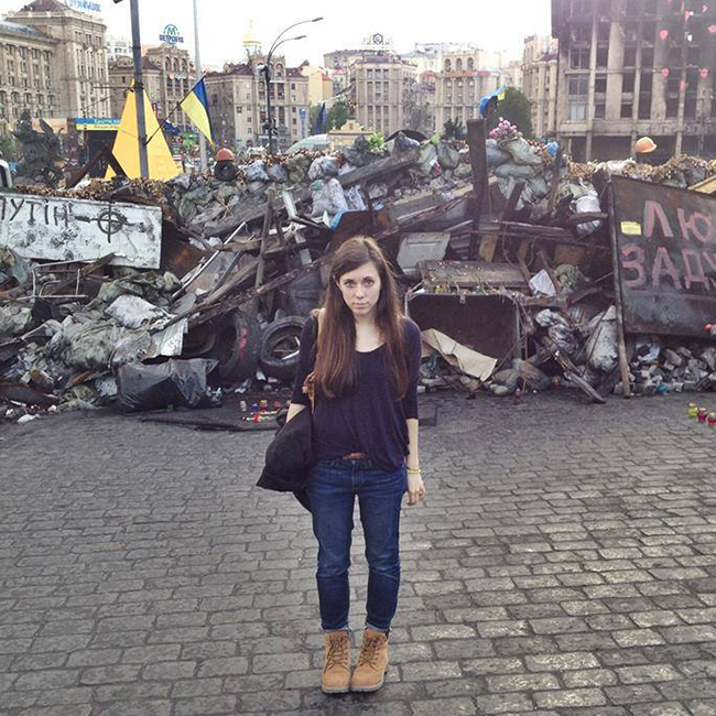 Sonya Bilocerkowycz stands in front of a barricade in Kyiv, Ukraine, in the aftermath of the Ukrainian revolution in spring 2014.