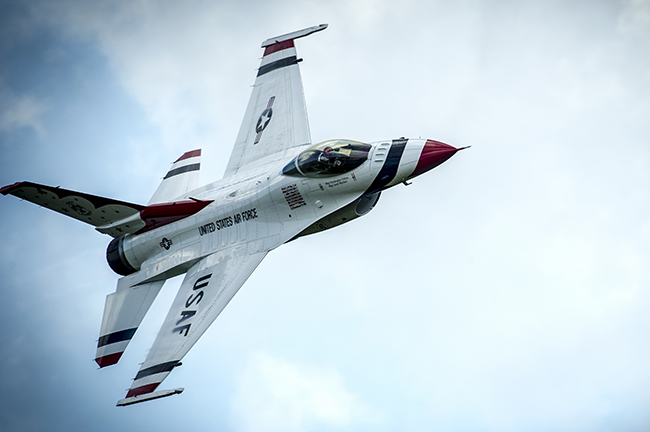 Thunderbird 6 performs the Sneak Pass maneuver during a practice show at Melbourne, Florida, Oct. 3, 2014. Photo credit U.S. Air Force.