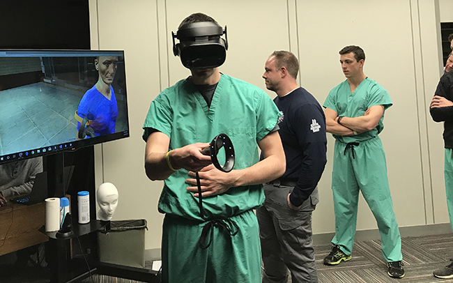 Medical students practice tending to virtual victims.