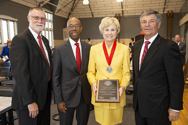 Barbara Andersen, Distinguished Professor of Psychology, stands with (from left) Ohio State Provost Bruce Mcpheron; President Michael Drake; and Board of Trustees Chair Michael Gasser.
