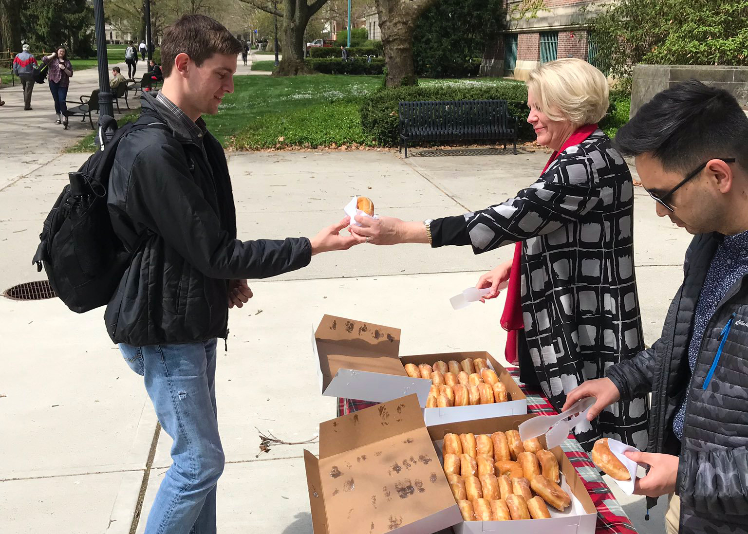 Dean giving out buckeye donuts