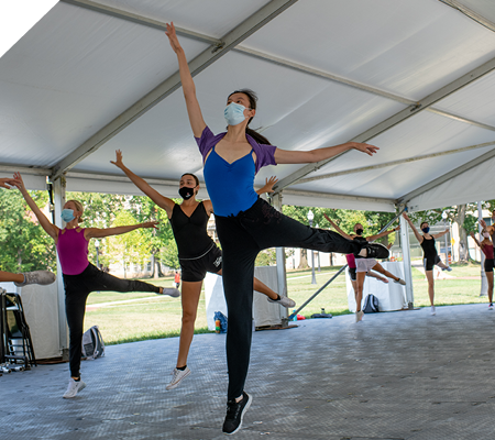 Arts tent with dancers inside