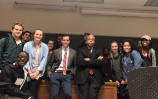 Eric Herschthal (center left) and Dr. Quinn Capers (center right) pose with students from the class they co-teach, AFAMAST 4326: Race