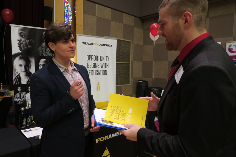 Career Success - Spring Career Fair - Student and employer talking