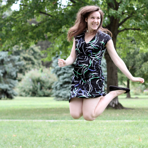 corrinne miller actuarial science alumna jumping into the air
