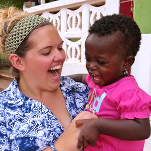 Kara Ford with a baby.