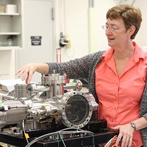 Vicki Wysocki setting up equipment in new lab.
