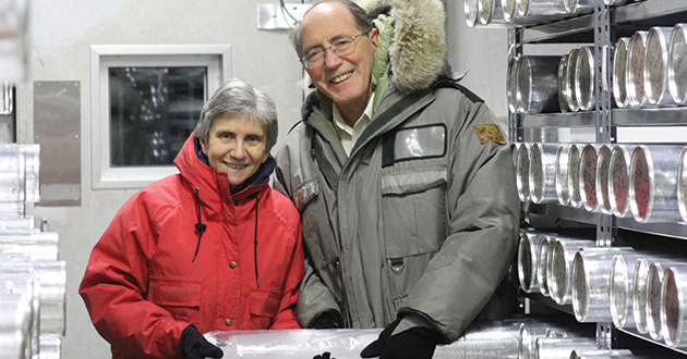 The Thompsons show off an ice core in one of the newly illuminated freezers at the Byrd Polar Research Center.
