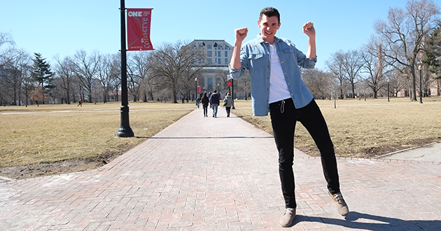 Cody Crothers dances on the Ohio State Oval.