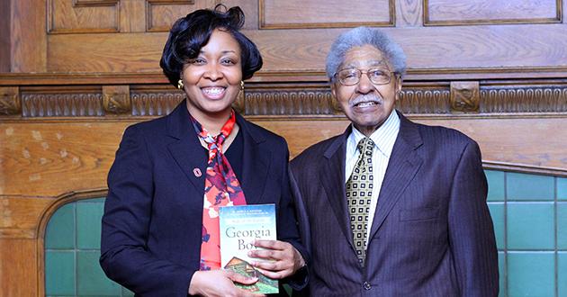Alumna and author Jessica Johnson with a Columbus legend, Dr. Willburn Weddington.