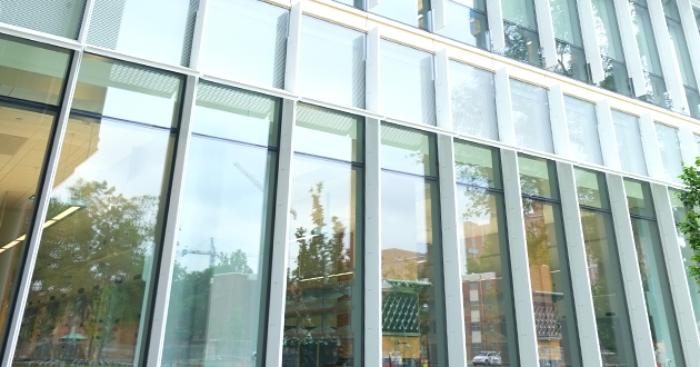 Photo of transparent floor-to-ceiling glass exteriors with sun-shielding mechanisms.