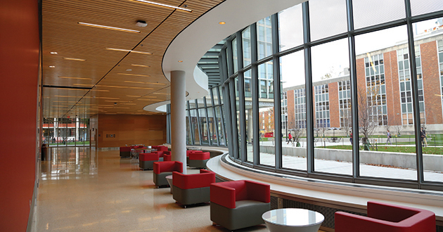 """Two-story, 140 ft. long """"wave wall"""" of trapezoidal glass panels that enclose the perimeter lobby and lounge spaces at ground level"""