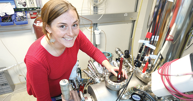SHAWNA HOLLEN, postdoctoral researcher at CEM, is positioning a sample for graphene growth on a copper crystal using a SPECS CreaTec low temperature scanning tunneling microscope system.