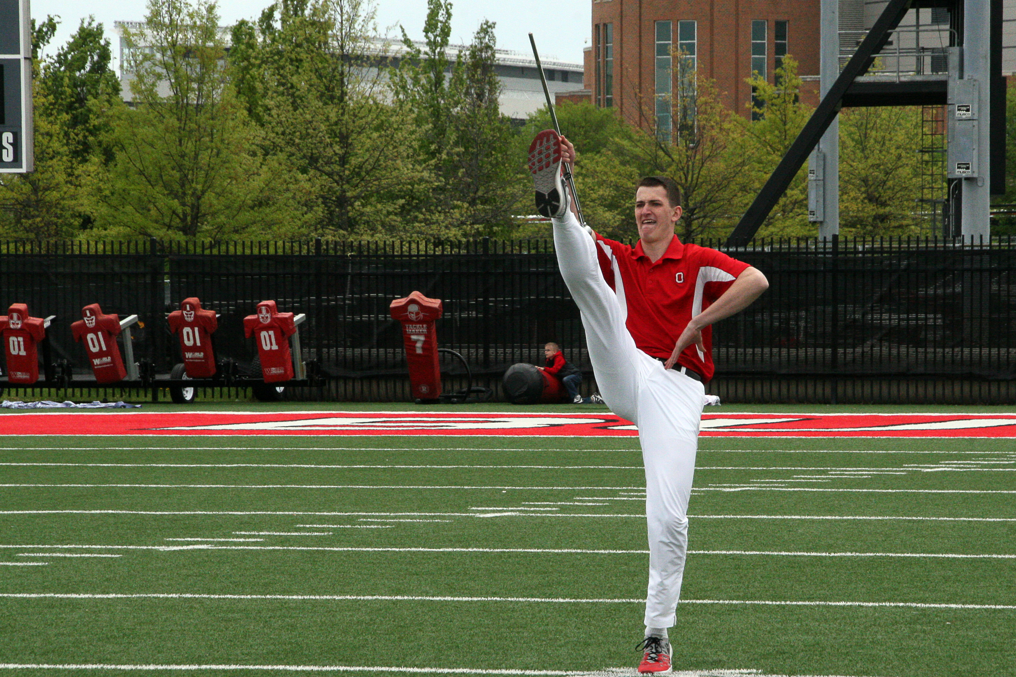 photo of Konner Barr performing toe-touch salute during 2017 drum major tryouts