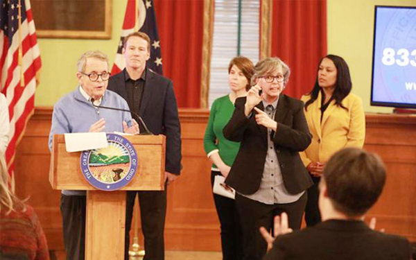 Marla Berkowitz interprets for Gov. Mike DeWine during a briefing on the coronavirus. Photo courtesy The Columbus Dispatch.