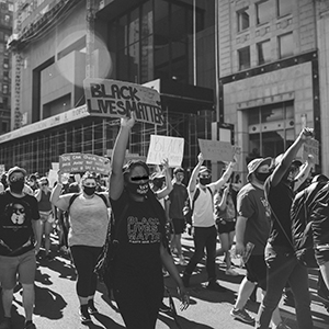 Protesters marching down Broad St. after rallying at the Ohio State House during week one of protests.