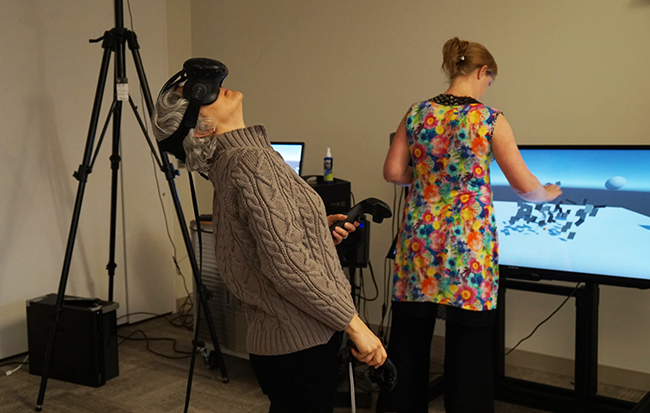 Researchers explore applications of virtual reality at the Advanced Computing Center for the Arts and Design.