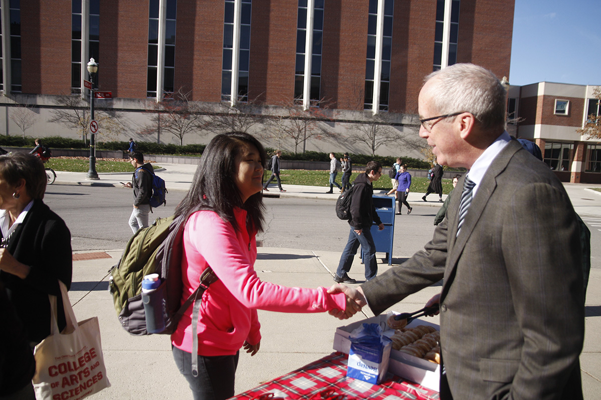 Dean Manderscheid meeting a student