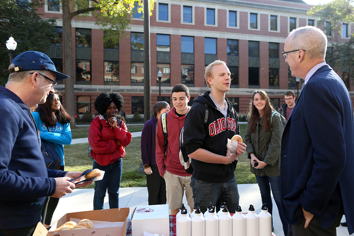 Dean Manderscheid talking with students