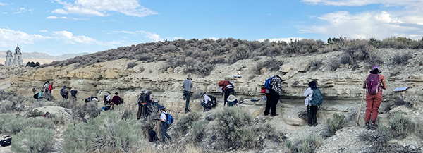 """Students examining the """"temple bed"""", fossiliferous limestone layers within the Green River Formation"""