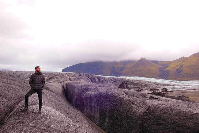 Forrest Schoessow, a PhD candidate in the Department of Geography, stands on a glacier in Iceland in September 2014.