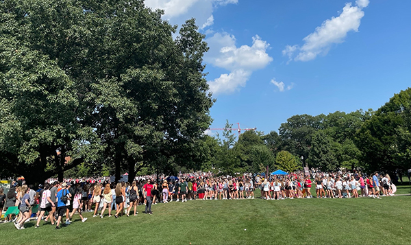 Student on the oval at the ohio state involvement fair