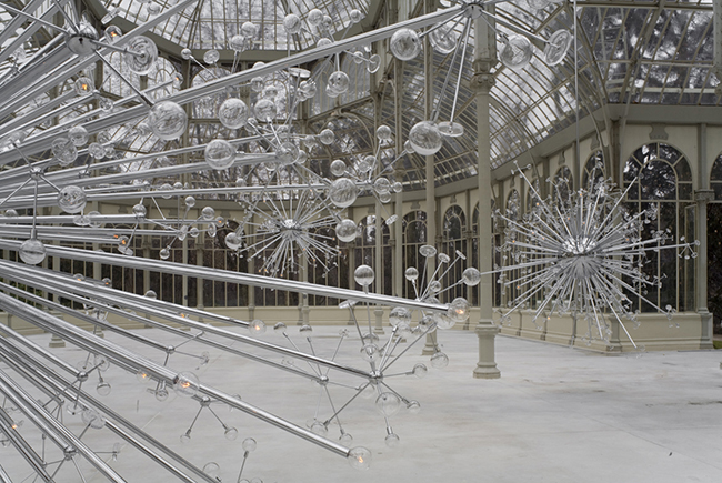 """Island Universe"" created by Josiah McElheny hangs at the the Palacio de Cristal of the Museo Reina Sofia in Madrid."