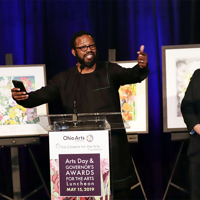Mark Lomax receives his Individual Artist Award at the Governor's Award for the Arts. Photo courtesy Terry Gilliam Photography.